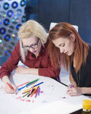 Teamwork: Two Creative Women Stock Photography
