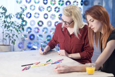 Teamwork: Two Creative Women Stock Images