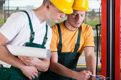 Teamwork of two factory engineers Stock Photography