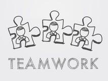 Teamwork- und Puzzlespielstücke mit Person Lizenzfreie Stockfotos
