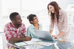 Teamwork using laptop and editing photos Royalty Free Stock Photos