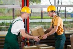 Teamwork at warehouse Stock Photo