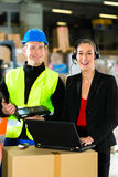 Coworkers at warehouse of forwarding company Royalty Free Stock Images