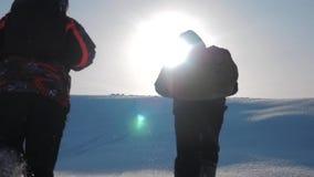 Teamwork winners. group men winter snow mountains team tourists joy success achievement raised their hands up rejoice