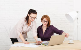 Teamwork. Women discuss project in office Royalty Free Stock Images