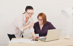 Teamwork. Women discuss project in office Royalty Free Stock Photos
