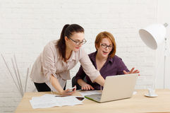 Teamwork. Women discuss project in office Stock Image