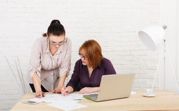 Teamwork. Women discuss project in office Royalty Free Stock Image