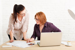 Teamwork. Women discuss project in office Stock Photography