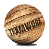 Teamwork on wooden ball Royalty Free Stock Photos