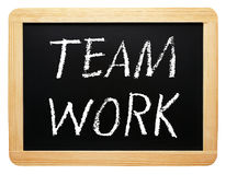 Teamwork - wooden chalkboard with text. On white background stock image