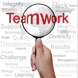 Teamwork, word in Magnifying glass Royalty Free Stock Photos