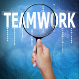 Teamwork, word in Magnifying glass Royalty Free Stock Images