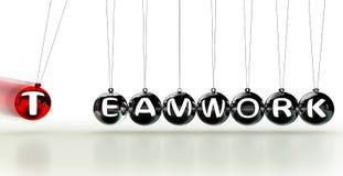 Teamwork word on newton cradle royalty free stock photography