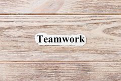 Teamwork of the word on paper. concept. Words of Teamwork on a wooden background.  royalty free stock photos