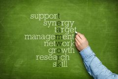 Teamwork word puzzle on blackboard royalty free stock photography