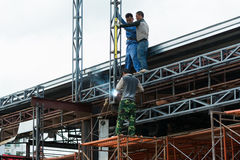Teamwork of workers Stock Photography