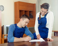 Teamwork of  workers in uniform reading financial documents at t Stock Photos