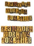 Teamwork working together letterpress Stock Image