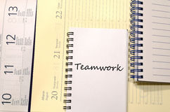 Teamwork write on notebook stock photography