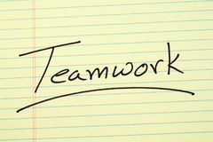 Teamwork On A Yellow Legal Pad Royalty Free Stock Photography