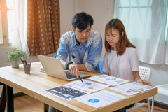 Teamwork, Young businesswoman in office in casual shirt. Selecting information with colleagues with a computer on the table. Royalty Free Stock Photos