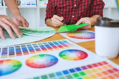 Teamwork of young creative designers working on project together royalty free stock images