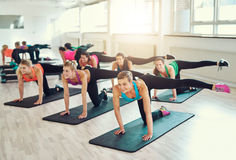 Teamwork of young women doing exercise together Stock Images