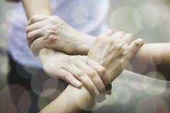 Teamwork-Zusammengehörigkeits-Zusammenarbeits-Konzept lizenzfreie stockfotografie