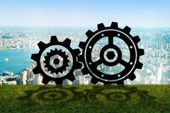 Teamworkbegreppet med kugghjulkugghjul Arkivbild