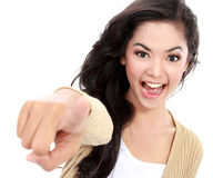 Teanager pointing her finger. Picture of attractive teenager pointing her finger at camera Stock Photo