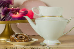 Teaparty with zeeuwse bolus and pink candles. Royalty Free Stock Photos