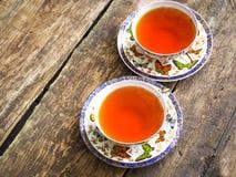 Teapot μαύρο τσαγιού πράσινο φλυτζάνι τσαγιού πινάκων τσαγιού παλαιό Στοκ Φωτογραφίες