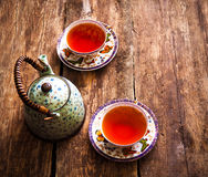 Teapot μαύρο τσαγιού πράσινο φλυτζάνι τσαγιού πινάκων τσαγιού παλαιό Στοκ Εικόνα