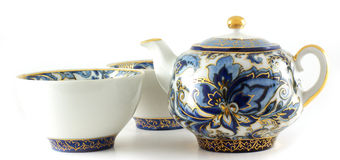 Teapot. And cups  over white background Stock Photos
