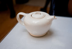 Teapot. White Charles Rennie Mackintosh teapot on a cafe table Royalty Free Stock Photos