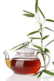 Teapot. With bamboo leaves on white background stock photography