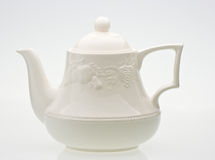 Teapot. A bright cream ceramic standard design teapot isolated on white Stock Photo