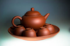 Teapot. Classic teapot with four cups Royalty Free Stock Photography