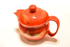 Teapot. Red teapot on a white background Stock Photography