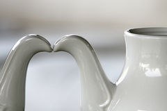 Teapot. Two porcelain white teapots in simple background Stock Photo