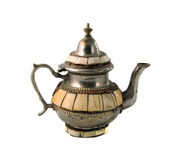 Teapot. Older Moroccan silver teapot on a white background royalty free stock photos