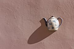 Teapot. Nice teapot as wall decor detail in Vilnius old town, Lithuania Stock Image