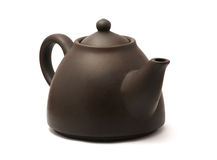 Teapot. Isolated brown ceramic chinese teapot. White background Stock Images