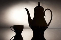 Teapot. Silhouette of teapot and glasses royalty free stock images