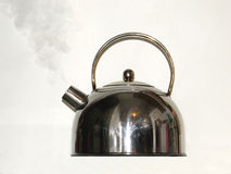 Teapot. Boiling teapot on a gray background Royalty Free Stock Photography