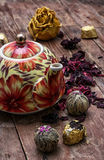 Teapot in the background of elite sorts of tea. The teapot in the background of elite sorts of tea.the image is tinted in vintage style Stock Image