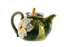 Teapot with a bas-relief of flowers. Porcelain teapot with a bas-relief on a white background Royalty Free Stock Photography