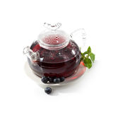 Teapot. Berries Tea with Fresh Mint royalty free stock photos