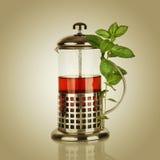 Teapot with black tea Stock Photo